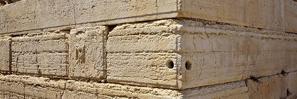 large sandy stones forming corner