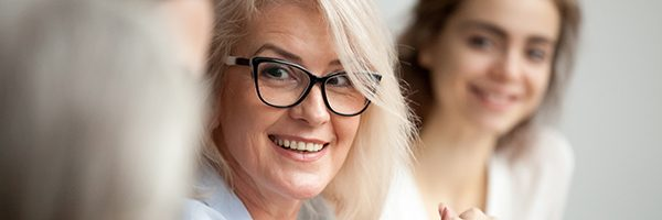 women with thick-rimmed glasses looking right
